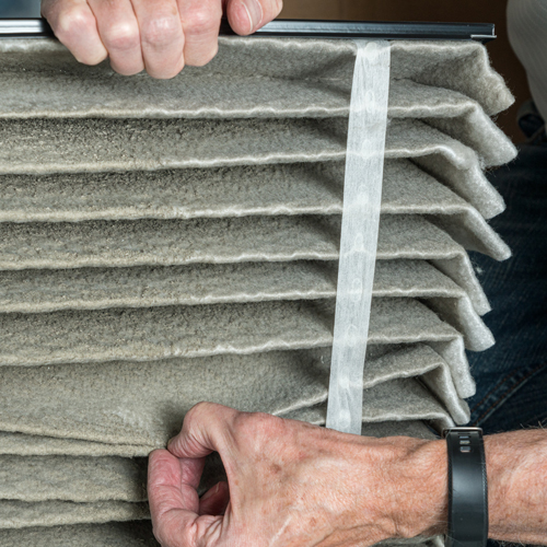 Landlord Showing Tenant's Dirty Air Filter